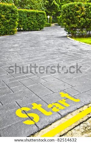 Start sign in the garden - stock photo