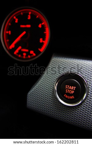 Start Stop engine button and tachometer in a sport diesel car  - stock photo