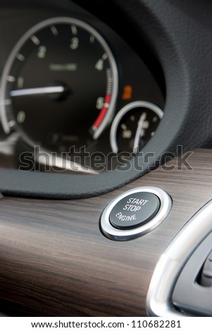 Start Stop engine button in luxury car - stock photo