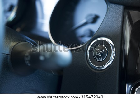 start stop engine button in the car - stock photo