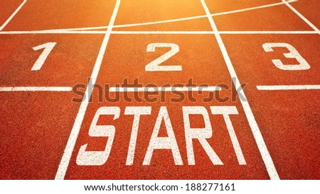 Start to run concept with numbers and word on running track - stock photo