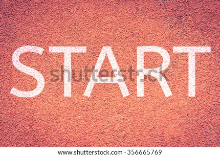 Start to run concept with word on running track,Red running tracks  run lane background texture,vintage color