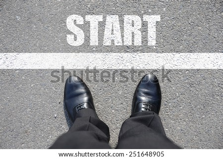 Start - top view of business man walking on the road - stock photo