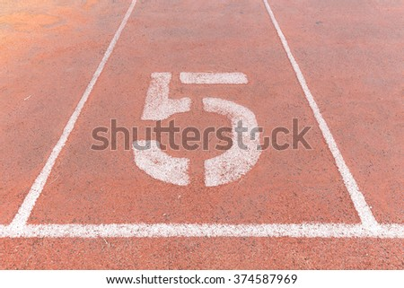 Start track. Lanes 5, number five of a red racing track. - stock photo