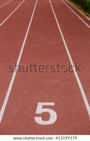 Start track. Lanes 5, number one of a red racing track. - stock photo