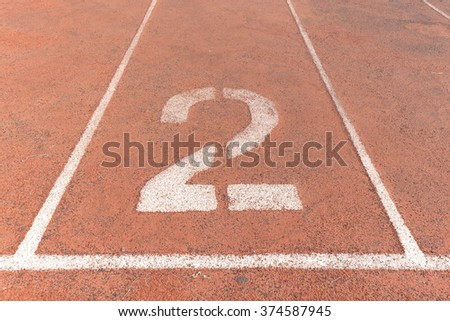Start track. Lanes 2, number two of a red racing track. - stock photo