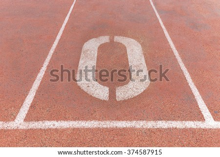 Start track. Lanes 0, number Zero of a red racing track. - stock photo