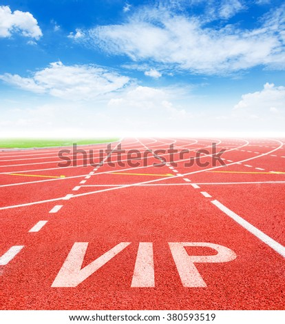 Start track. Lanes VIP on red racing track and blue sky. - stock photo