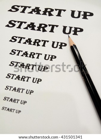 Start-up  Business  Concept on print paper and pencil