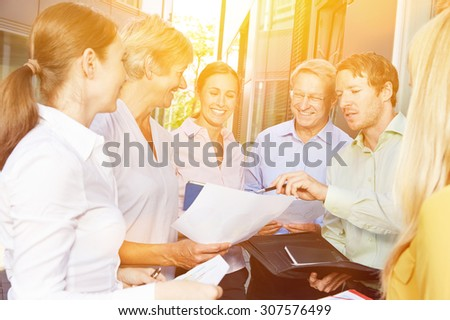 Start-Up Business Team Meeting outside the office in summer - stock photo