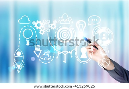 Start up concept with businessperson hand drawing digital sketch on abstract blue background - stock photo
