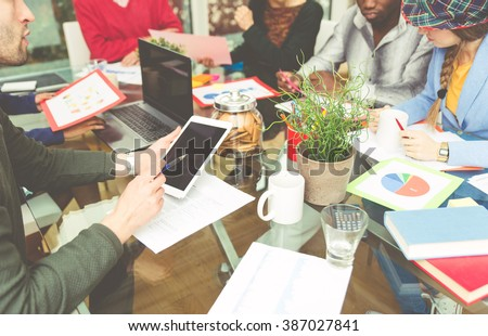 Start up team at work in a office. Innovative research area. Group of people working together to find new business solutions - stock photo