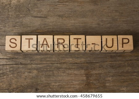 start-up text on wooden cubes