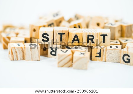 Start, words made out of alphabet wood pieces on white background