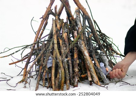 starting a fire in the snow. Winter in Ukraine - stock photo