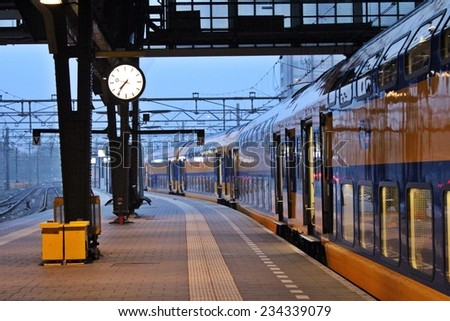 Starting a new day moving in Amsterdam, Europe by train / Train on duty ? Good morning Amsterdam - stock photo