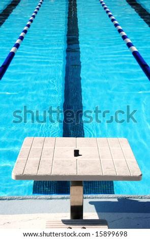 Starting block at end of swim lane - stock photo