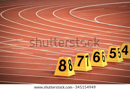 starting block in track and field, Athletics Track Lane Numbers. - stock photo