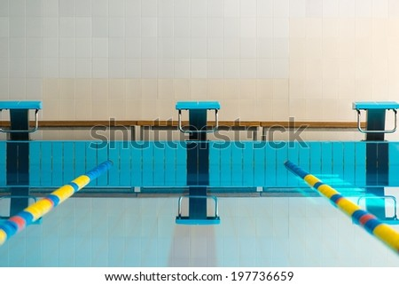 Starting blocks and lanes in a swimming pool  - stock photo