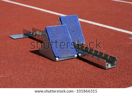 Starting blocks at the start - stock photo