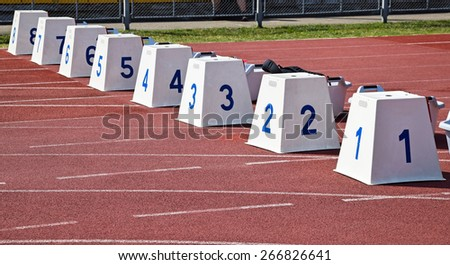 Starting blocks of the running track - stock photo