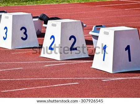 Starting blocks of the running track - stock photo