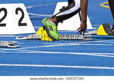 Starting female sprinter - stock photo