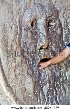Starting from the Middle Ages, it was believed that if one told a lie with one's hand in the mouth of the sculpture, it would be bitten off. - stock photo