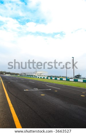 Starting grid in front of the pit lane of Killarney Race Track in the Western Cape, South Africa. Cloudy and wet race day. - stock photo