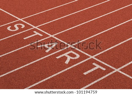 Starting line as a business symbol of the metaphor saying ready set go for the start or beginnings of a planned strategy for success as represented by a track and field stadium background. - stock photo