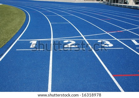 Starting line of blue running track - stock photo