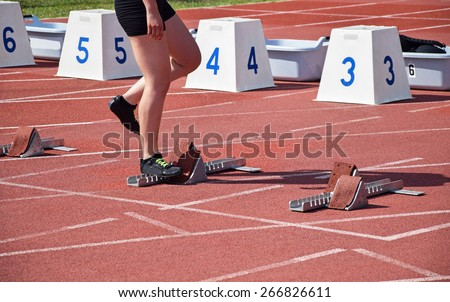 Starting line of the running track - stock photo