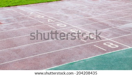 starting line of track on the ground of stadium