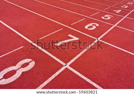 starting line with numbers of track and field sports - stock photo