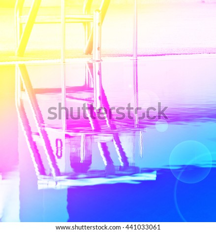 Starting platforms for swimming races with color filters - stock photo