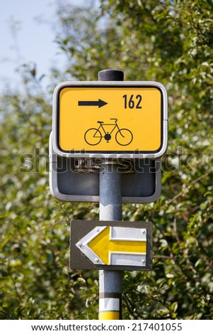 Starting point for cyclists on metal poles in the rural landscape - stock photo