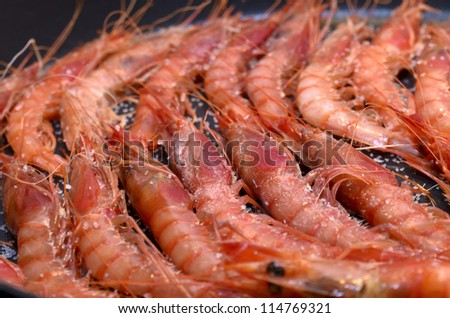 Starting to cook a plate of shrimps