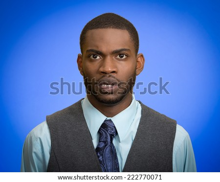 Startled Closeup portrait speechless insulted shocked stunned surprised young man in disbelief isolated blue background. Negative human emotion facial expression bad feeling body language panic attack