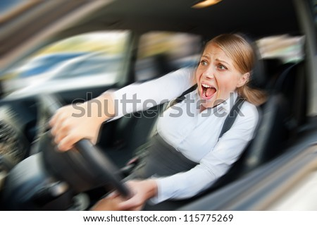 startled female driving the car and screaming - stock photo