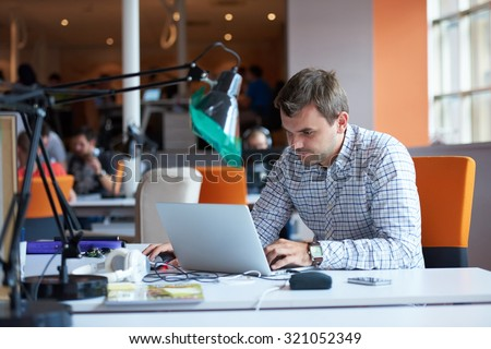 startup business, software developer working on computer at modern office - stock photo