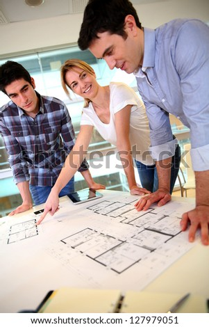 Startup business team working on blueprint