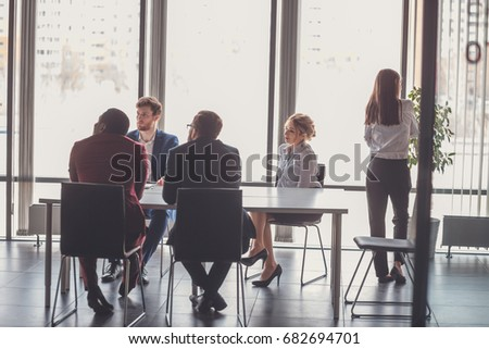 Startup business young creative people group entering meeting room modern office interior