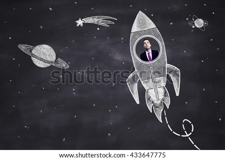 Startup concept with businessman inside abstract space ship sketch on chalkboard background