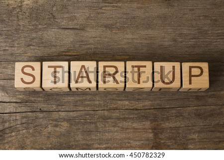 STARTUP word on wooden cubes - stock photo