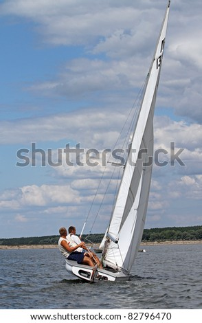 STARY SALTOV,UA - AUGUST 6: Class Flying Dutchman sailing boats with unidentified participants compete during Slobozhanshina Sailing Cup. August 6, 2011 in Stary Saltov, Ukraine - stock photo