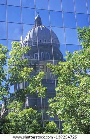 State Capitol of Idaho reflected in a building in Boise, Idaho - stock photo
