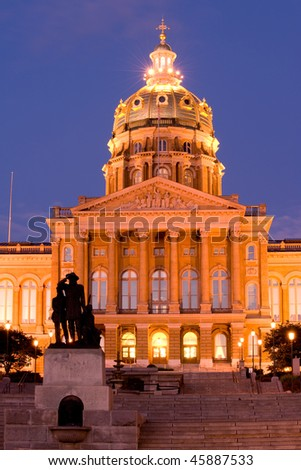 State Capitol with Pioneers sculpture in Des Moines, Iowa - stock photo