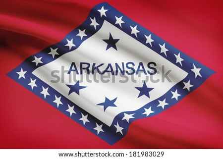 State of Arkansas flag blowing in the wind. Part of a series. - stock photo