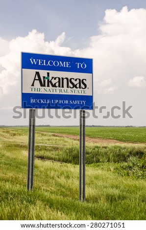 State of Arkansas welcome sign tells you it is The Natural State and to buckle up for safety - stock photo