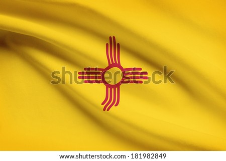 State of New Mexico flag blowing in the wind. Part of a series. - stock photo